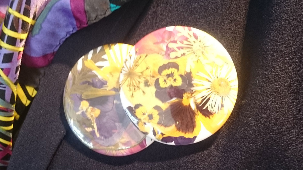 Two badges using real pressed flowers.