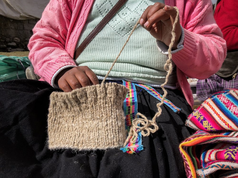 Hand spinning yarn & knitting takes hours, and is a daily routine for artisans in the Andes.