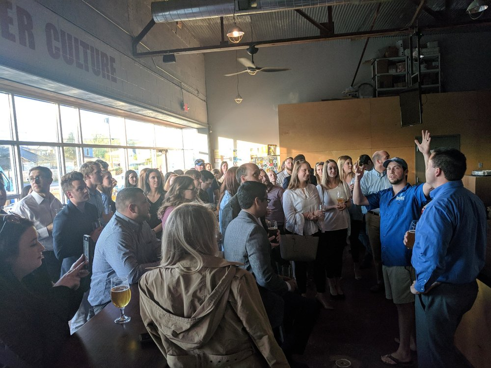 YPK members learning about the history of Alliance Brewing Company from co-owner, Alan Howard, during the April 2018 Happy Hour.