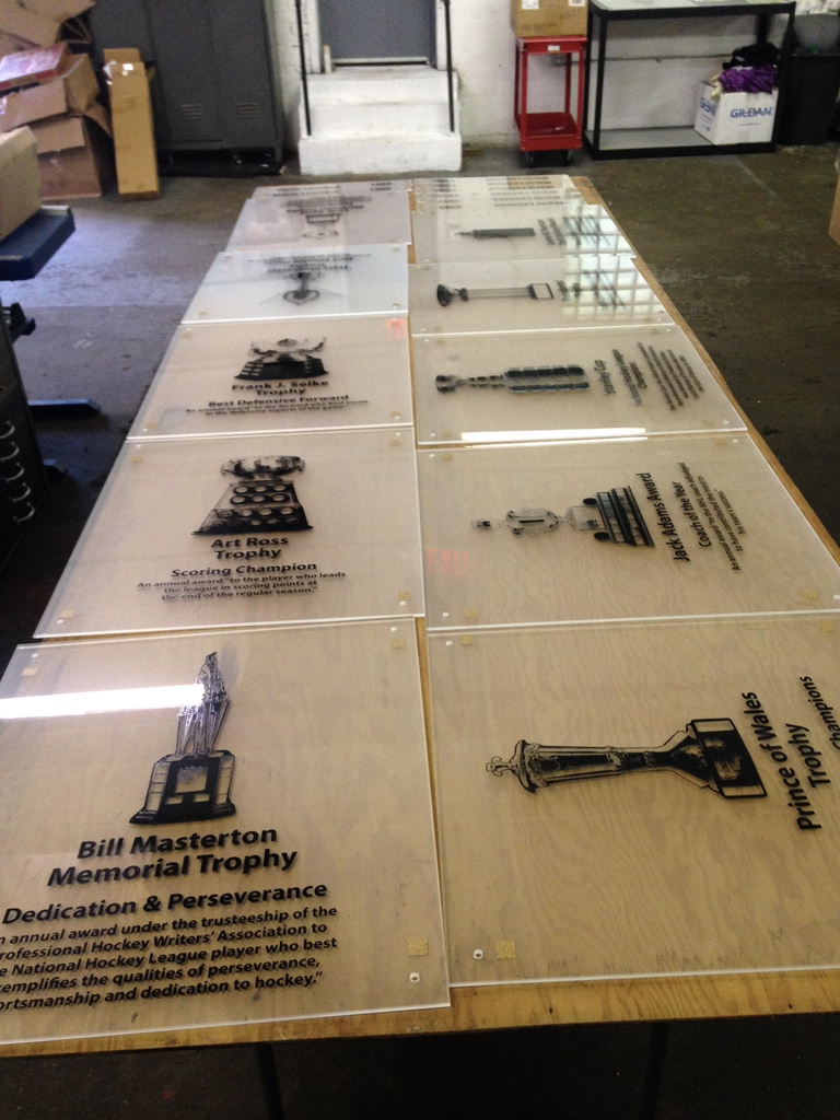 Pittsburgh Penguins , 2015. - Agency contract project.  Screen printed glass panels for the Pittsburgh Penguin trophy wall display.