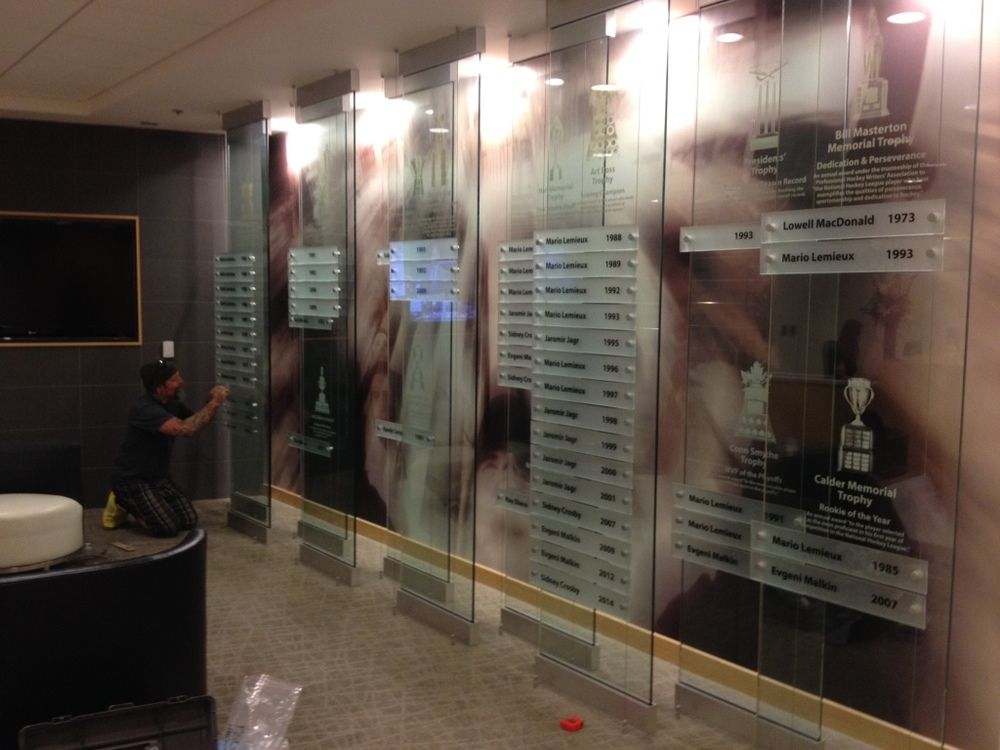 The Pittsburgh Penguins.  2014. - Agency contract project.  Screen printed glass panels for Pittsburgh Penguins trophy wall at Consol Energy Center, Pittsburgh, PA.
