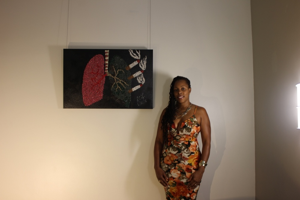 "Lisa Foster with her art piece ""Choice"""