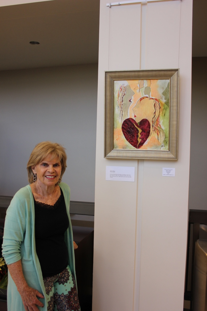 "Joanne Allison with her art piece ""Life Cut Short"""