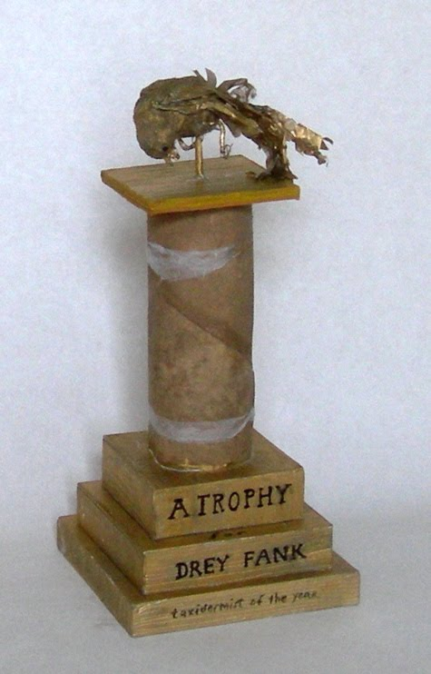 A Trophy, 2011 Polymer clay, wire, cardboard, paper, ink, paint pen, cotton, cut and rolled and dyed bristol with blotter paper