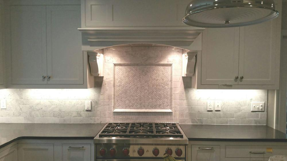 Marble backsplash with picture frame in Sherborn