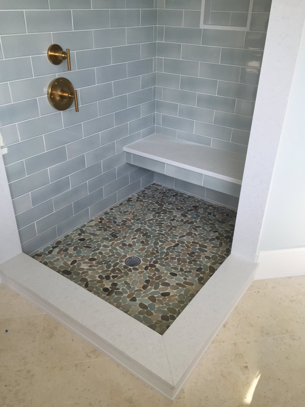 Subway tile with Pebble floor