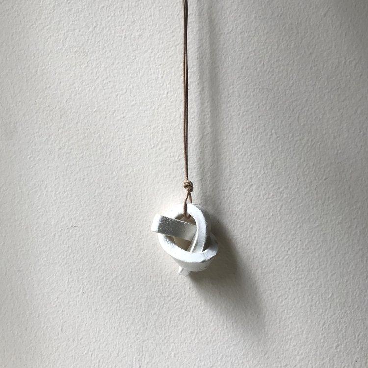 "MINI UNION KNOT | SALT  ceramic knot on leather cord approx. 2""L, 1.5""H, 1""W (varies) $20 Wholesale | $40 Retail"