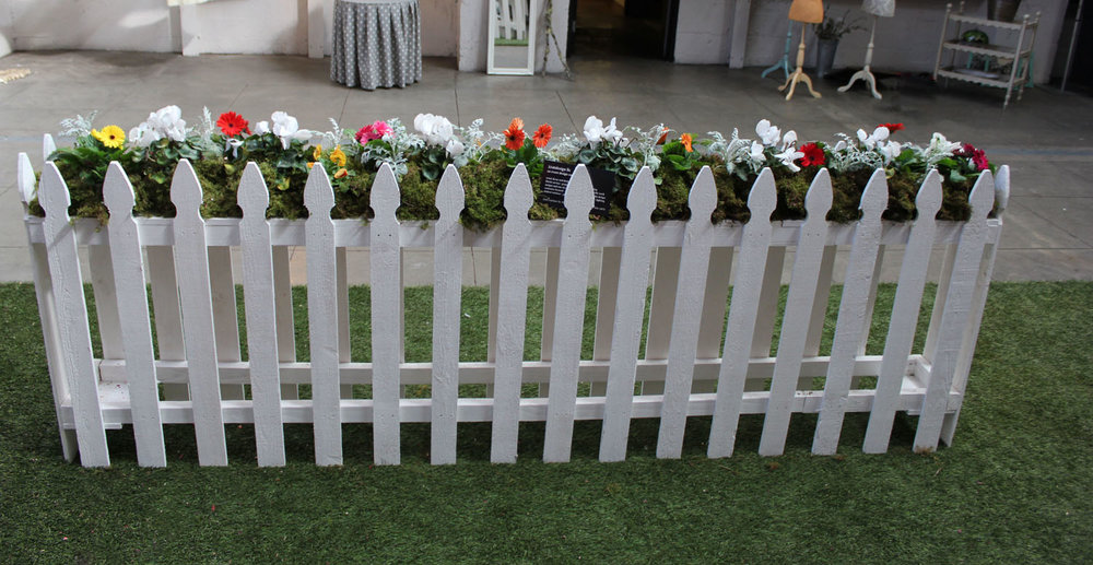 Laura Phelps Rogers Creative Director 3240design llc installation with dresses and picket fence floral installation for GDVN Event City Hall SoCo Nightlife.jpg