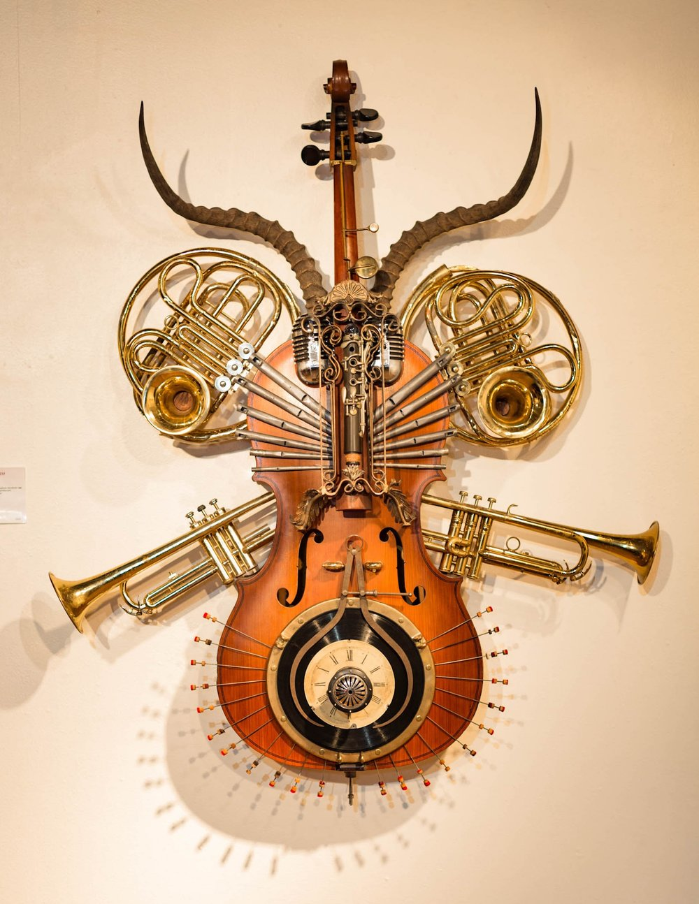 · Concert Cello  · African Impala horns  · 2- French Horn manifolds  · 2- trumpets  · 2- trumpet bells  · 1890's lead pipe organ pipes and brass reed  · Electro Voice Cardyne II, Model 731 microphone  · Wooden lower tube clarinet & bell  · Tenor Sax rod and pads  · 2- 78 Classical records  · Mid 19th century clock dial  · 1908 gramophone reproducer cage  · Brass ship window port  · 1860's square grand piano damper push rods  · Large caliper  · Art Deco Candle Sconce