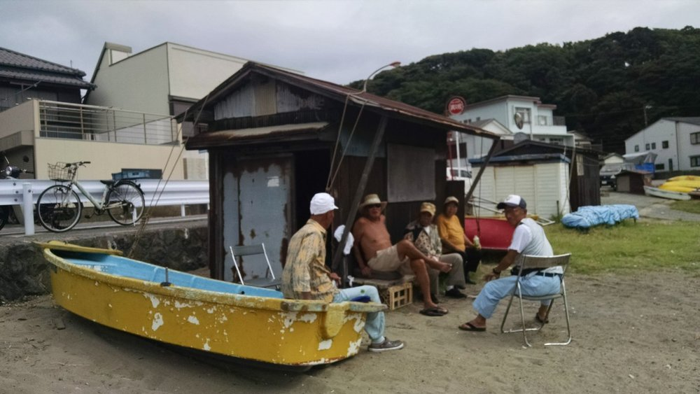 Local fisherman checking out the gaijin taking their photo.