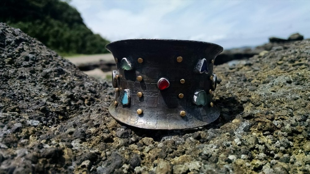 The cuff that started it all-made with sea glass (except for the red) purchased from Barbie. Photographed on the beaches where glass was found.