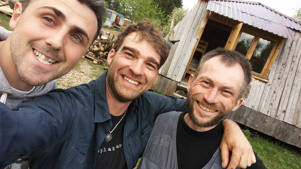 """Jeffro (center) and two of his Russian carving buddies in their """"carver's camp""""."""