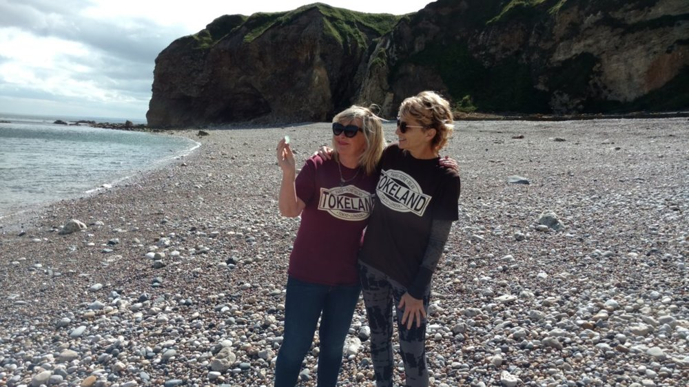 Sea Glass Sister. Jane and I examine the sea glass she she picked up that was lying at our feet!