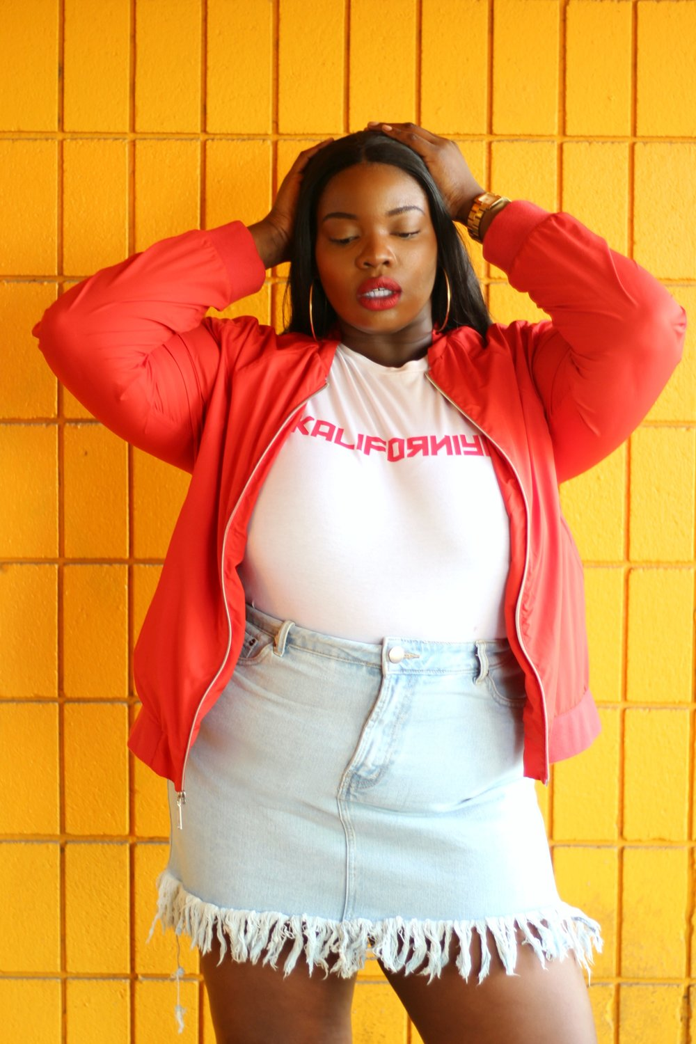 BORN IN KALI/CALI - I'm a 90's baby, born in Southern California, raised in Lagos, so yes I had to buy this tee (Shop HERE). Check out some of my favorite plus size graphic t-shirt designs below. The red bomber jacket is thrifted, but you can find a similar style on ASOS - Click HERE.
