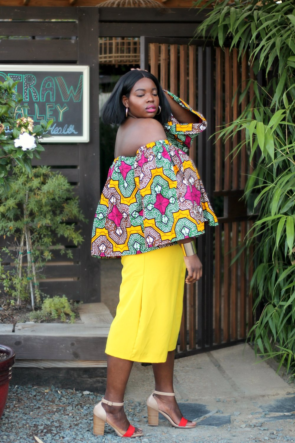 Bright Colored Prints - Never be afraid to rock bold prints. If you are, what better time to try it out than on a vacay? Pair your print with a solid color piece, a matching print, or if you're feeling adventurous, mix and match your prints. This gorgeous top is from Grass Fields.
