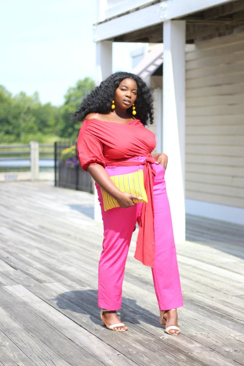 1. BE BOLD - Don't be afraid to rock bright colors. The brighter the better. When matching colors, pick from the opposite sides of the spectrum. The Color-Block trend works even better when each color is a distinct shade. I recommend 2 - 5 colors max. I paired this stunning ELOQUII plus-size RED blouse with HOT PINK pants, and YELLOW accessories.