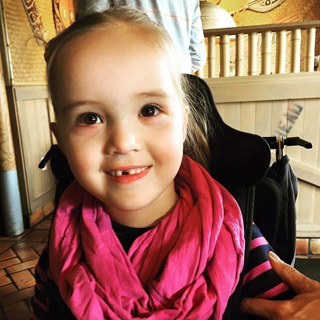 "MEET OLIVIA! • ""Olivia was diagnosed at 6 months of age with Canavan and at the time, we did not know what to expect.  She does have an atypical case of Canavan in that she can walk in a walker and stand with a stander, do minimal sign language and has a limited vocabulary.  She enjoys being in our pool at home, music, being with her family, flipping pages in books and grabbing objects and throwing them on the ground to get a reaction!  We are so blessed to have her in our lives and love her with all our heart!"" -Sacha F."