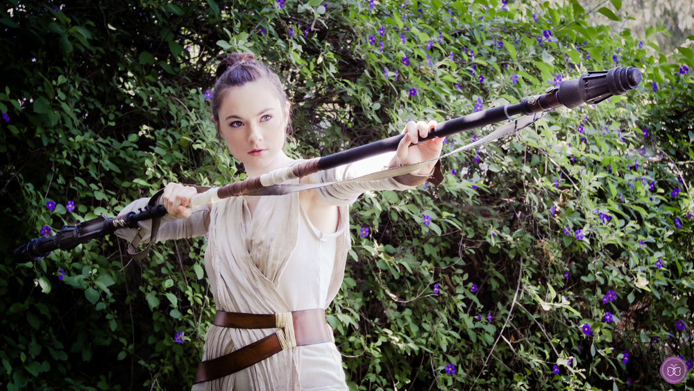 Our 'Rey' lookalike costume has been meticulously recreated. including  her life-  size bo staff replica. We're confident she will impress your guests as well as entertain.