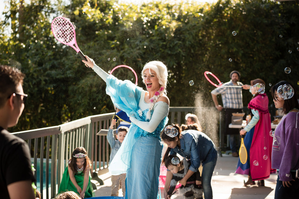 queen elsa frozen party character beverly hills plays with bubbles.jpg