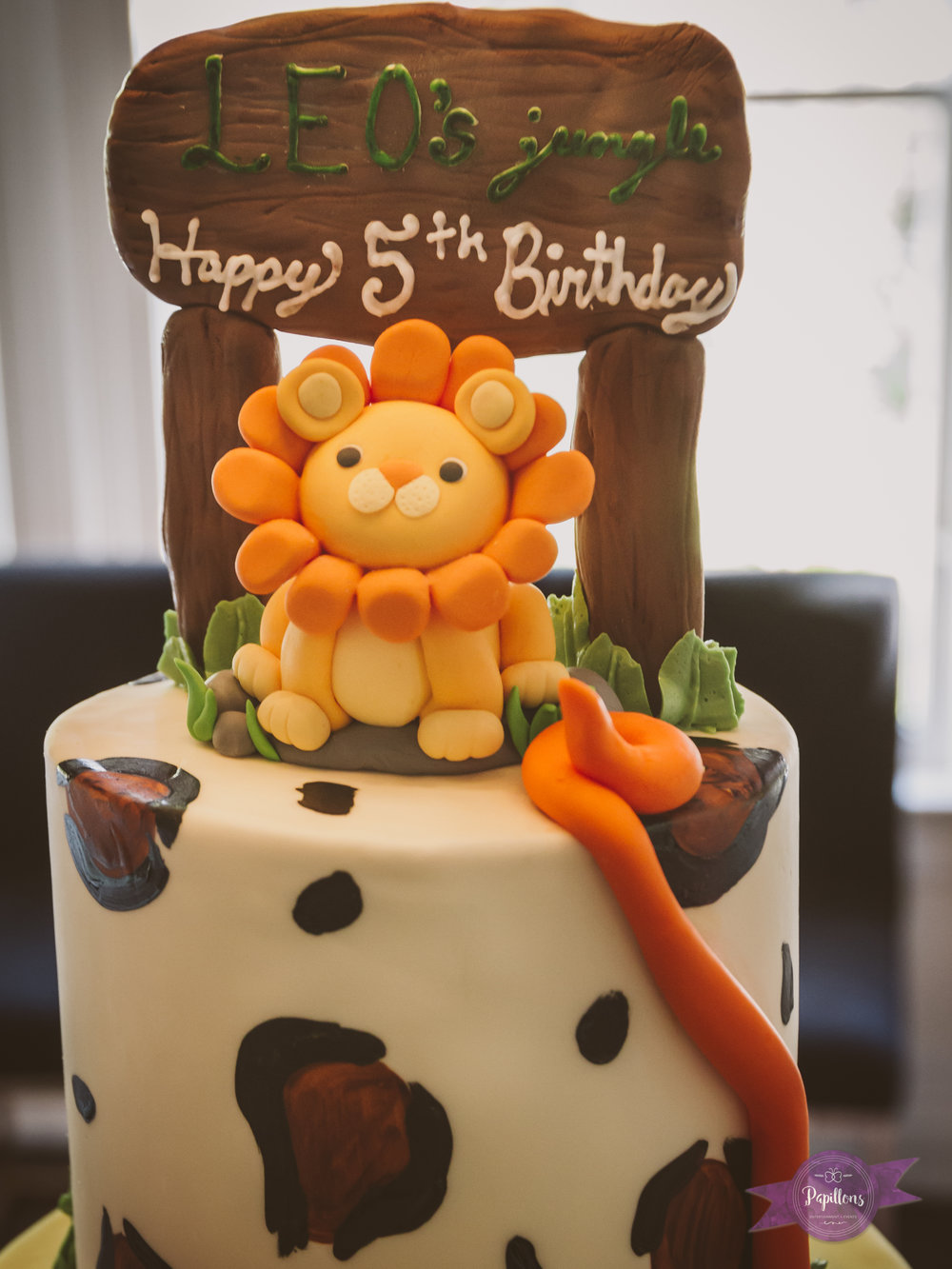 leo safari party cake topper.jpg
