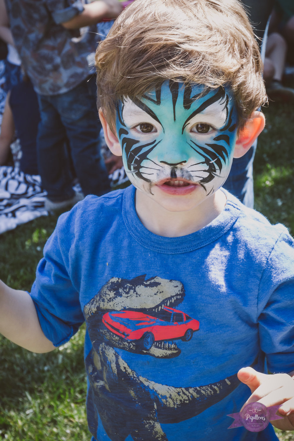 leo safari party colin jungle cat face paint.jpg