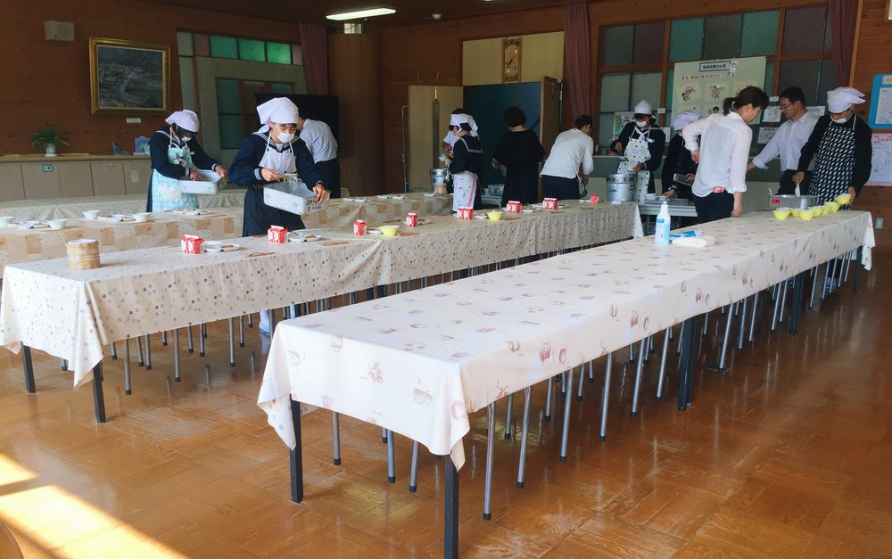 Japanese middle school students serve lunch