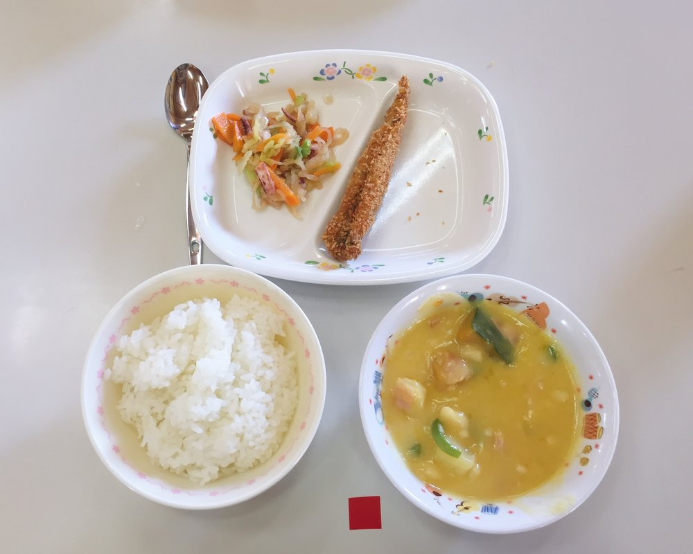 Breaded fried fish, squid salad, soy milk pumpkin stew, and white rice