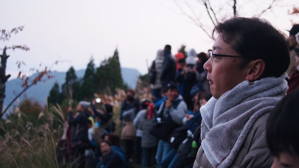 The crowd of people gathered to see the Takeda Castle Ruins at sunrise