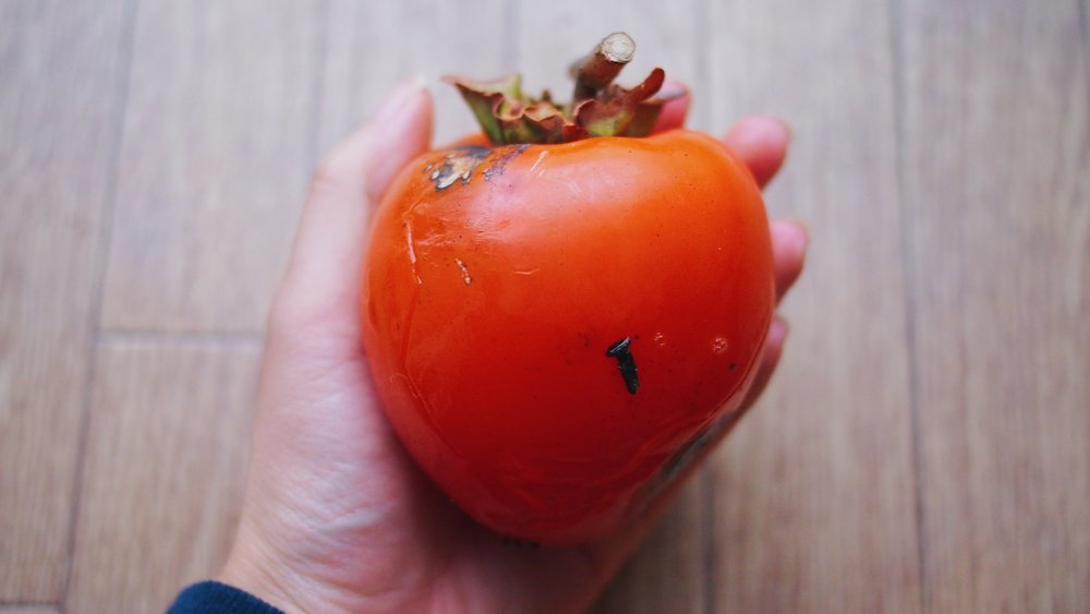 A ripe hachiya persimmon