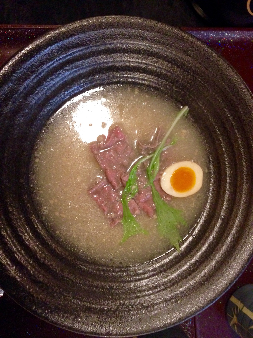 Kobe beef cooking in ramen broth.