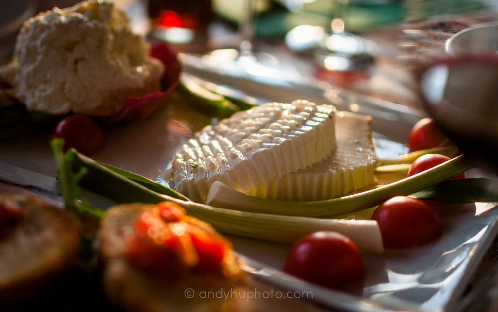 Traditional Albanian goat cheese is served with cherry tomatoes and spring onions