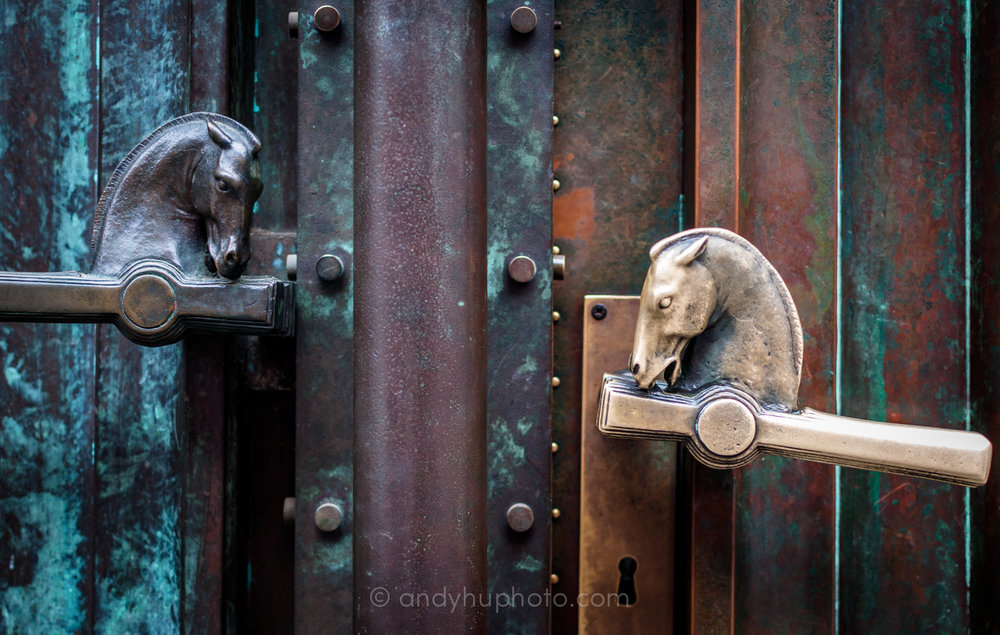 The pair of pegasus heads adorning the door handles of the National and University Library of Slovenia, designed by Jože Plečnik, one worn by time and touch