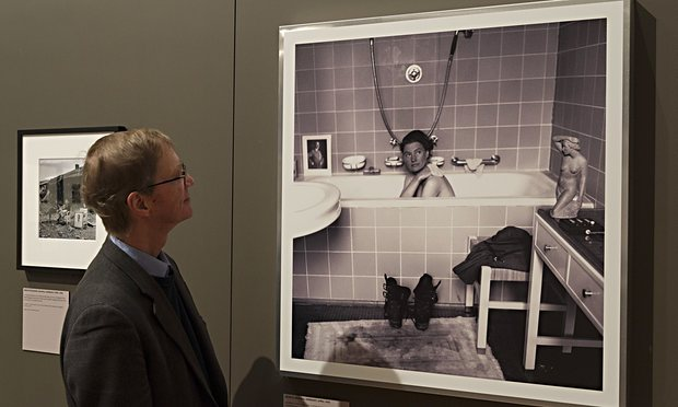 Tony Penrose looks upon his mother, photographed in Adolf Hitler's bathtub, 1945 - David E Scherman.