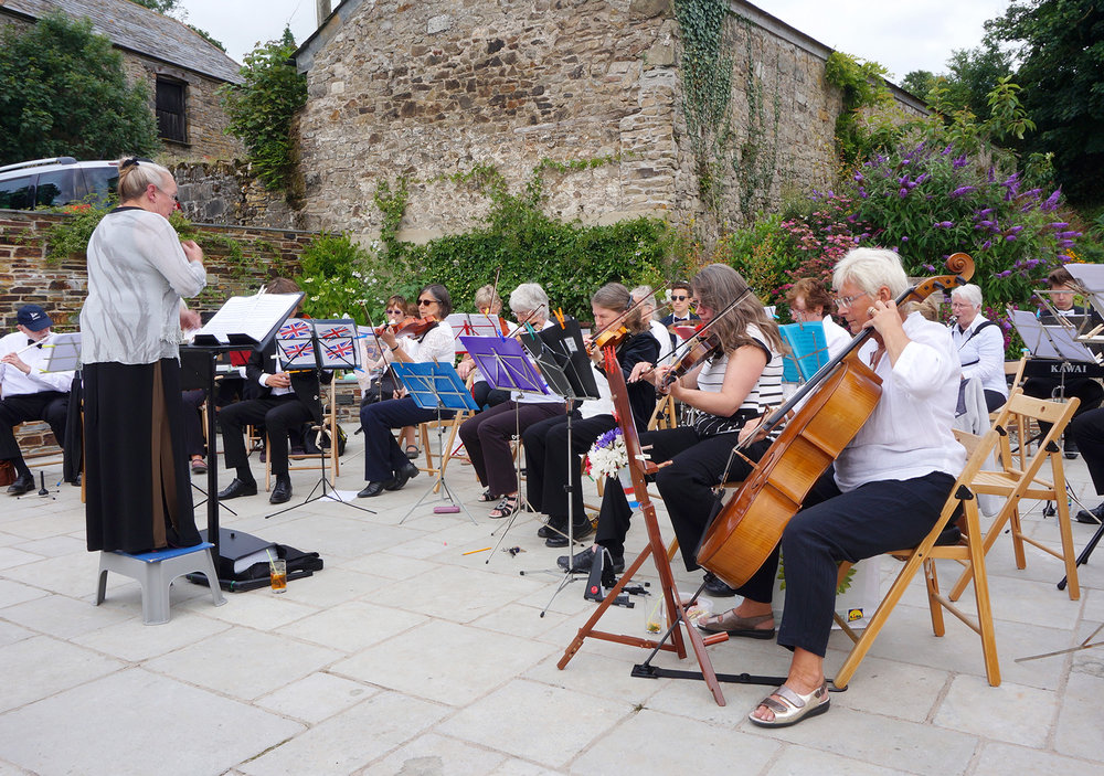 outdoor event orchestra playing at Pengenna Manor