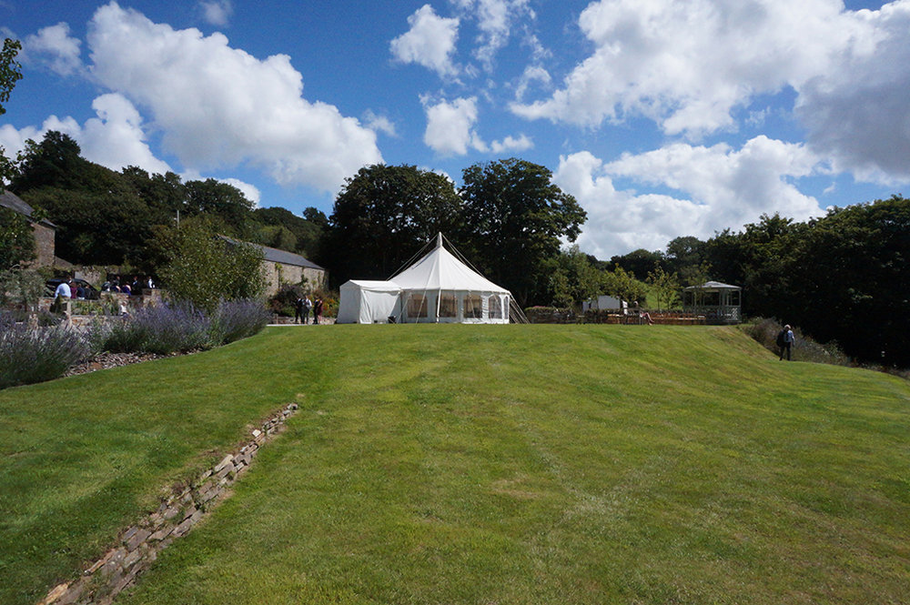 A traditional reception marquee on the lawn at wedding venue Pengenna Manor in Cornwall.jpg