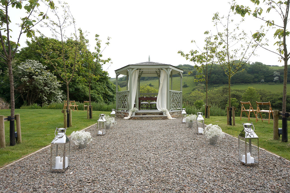 Stylish outdoor wedding ceremony setup at wedding venue Pengenna Manor in Cornwall.jpg