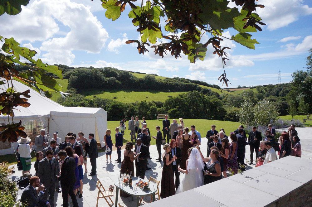 Outdoor summer wedding drinks reception at Pengenna Manor in Cornwall.jpg