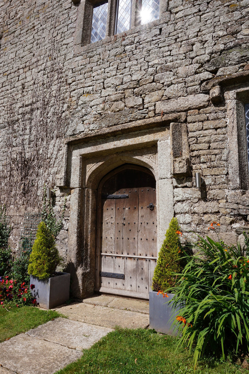 The front door of Pengenna Manor Cornwall wedding venue for elopement weddings.jpg
