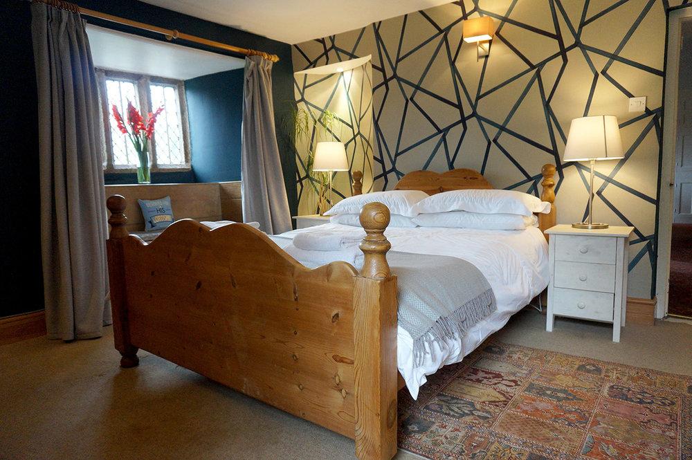 Luxury accommodation at wedding venue Pengenna Manor in Cornwall downstairs bedroom 01.jpg