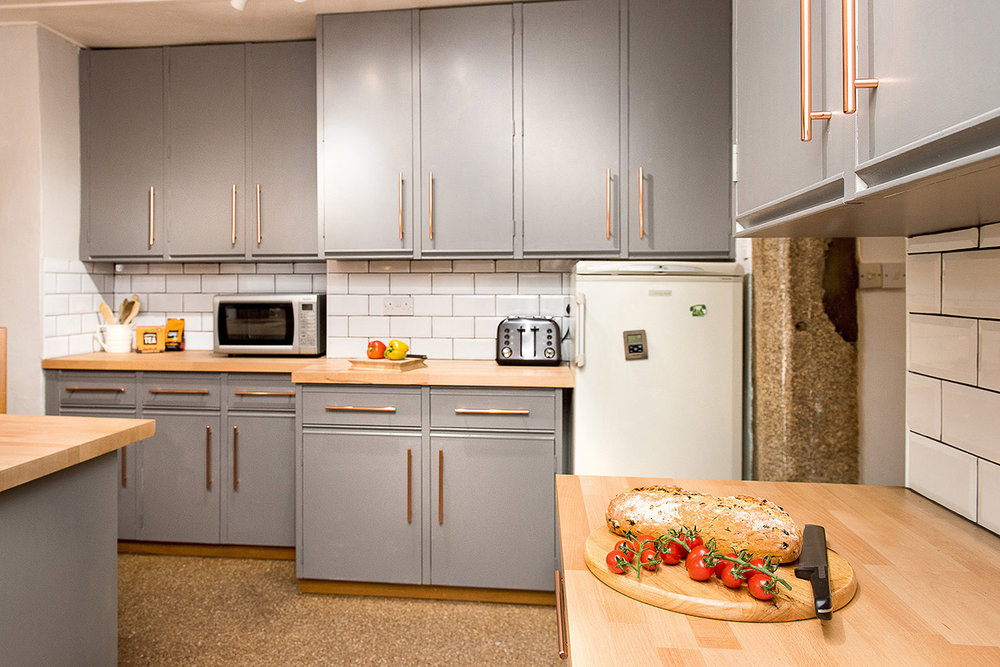 Luxury accommodation at wedding venue Pengenna Manor in Cornwall kitchen 01.jpg