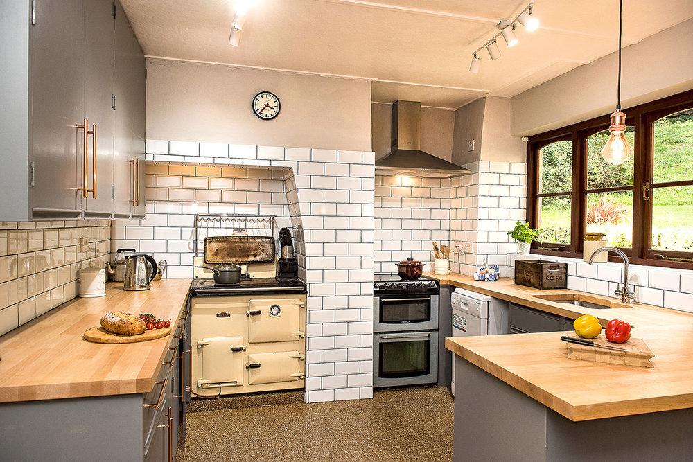 Luxury accommodation at wedding venue Pengenna Manor in Cornwall kitchen 03.jpg