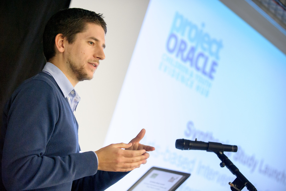 Dr. Simon McMahon presenting Project Oracle's latest Synthesis Study