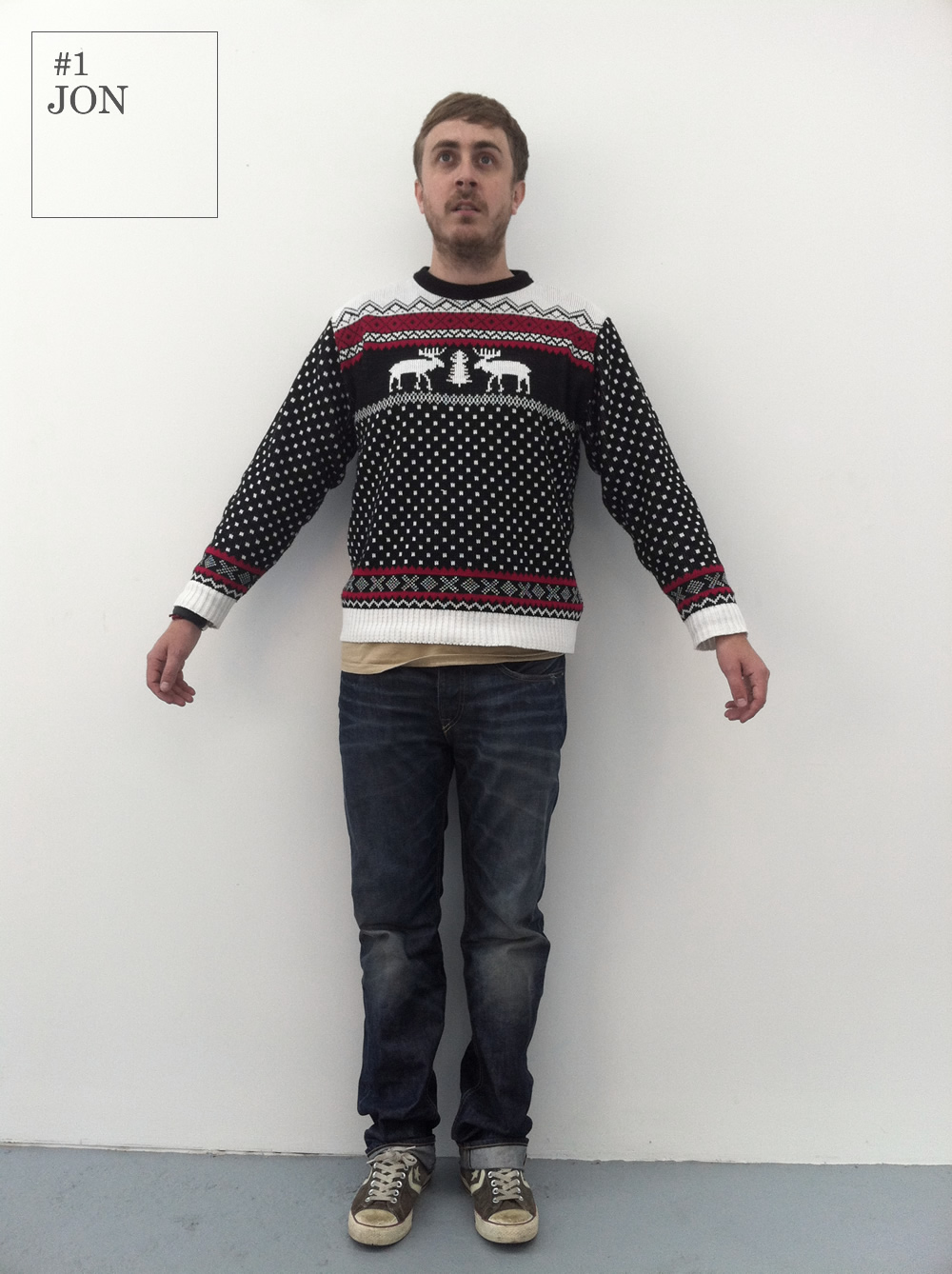 Jon demonstrates how to manage the difficult transition between spring/summer and autumn/winter with his unique sartorial approach. In an unorthodox pairing, he combines designer jeans with vintage knitwear for a unique, fashion forward daywear look. Who said jumpers were just for Christmas?     Jeans: Flying Horse     Jumper: Model's Own