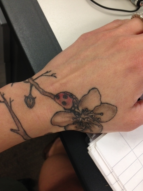 Final ladybird and Flower tattoo