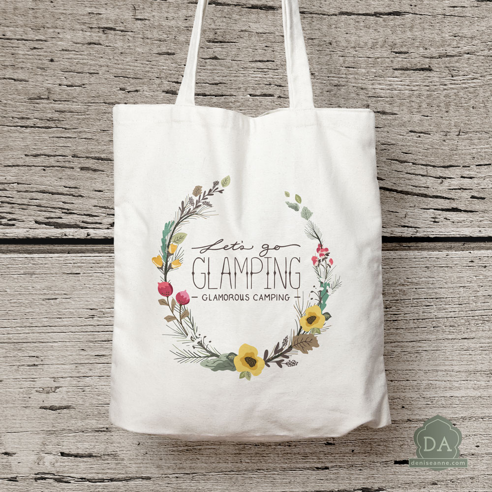 "Graphics ""Let's go glamping - glamerous camping"" hand lettering, and woodland pine open wreath tote bag product mock-up."