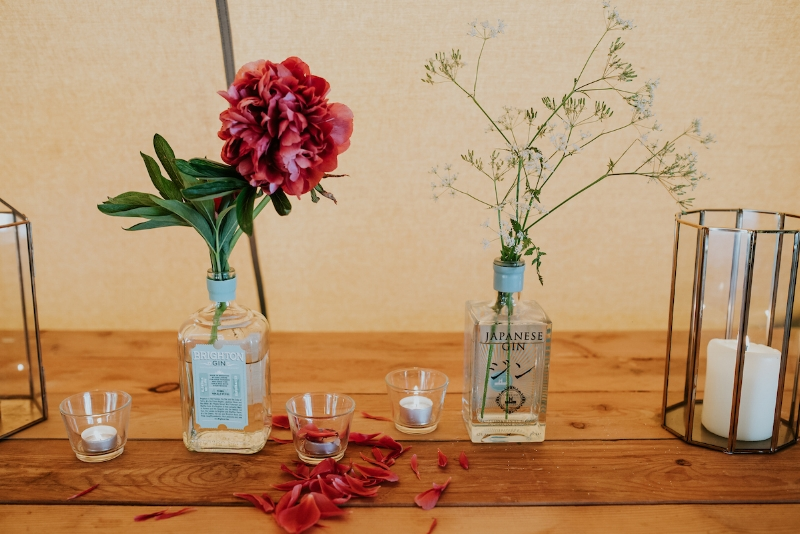 Winning combination of Gin bottles, foraged flowers and April's lanterns and styling skills!