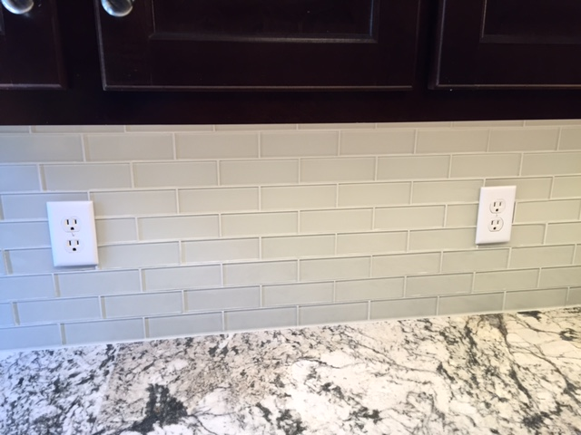 This is a glass backsplash with Mapei Flexcolor grout in Dallas, GA completed 5/16. Glass is very fashionable and also functional as a splash. Glass comes with an added labor and material cost. Further explanation in a future blog post.
