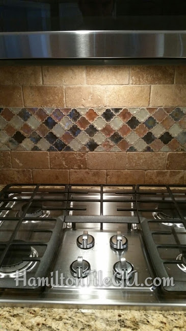 Stacy's backsplash finished 11/15/16 in Marietta. Mapei full silicone caulking with glass inset into natural stone.