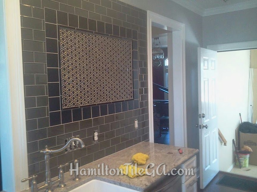 A very unique backsplash by referral from the electrician.