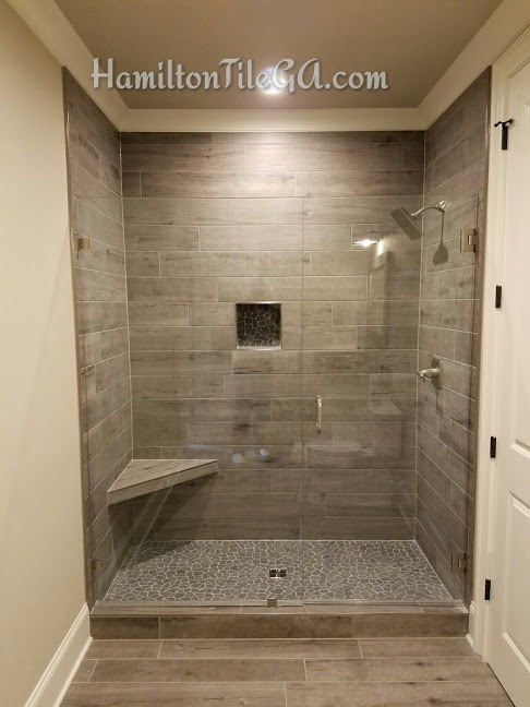 This is a custom plank tile shower and it is one of a kind. You have many options for your tile installation but I guarantee you, when we have completed your project you will regard using Hamilton Tile as a great decision.